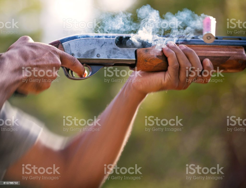 Shotgun fired and shell expelled stock photo