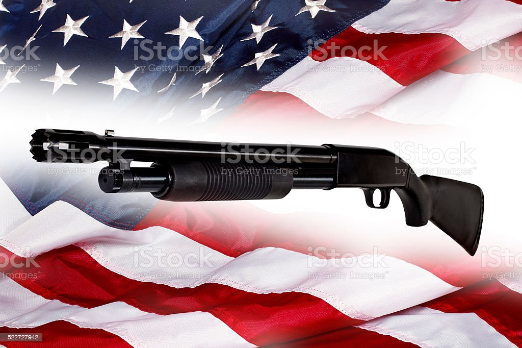 Shotgun Police Pump Action Made in USA on American Flag stock photo