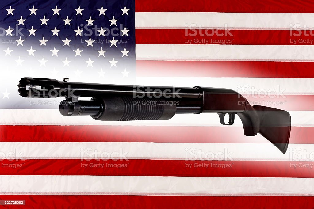 Shotgun Police Pump Action Made in USA with American Flag stock photo