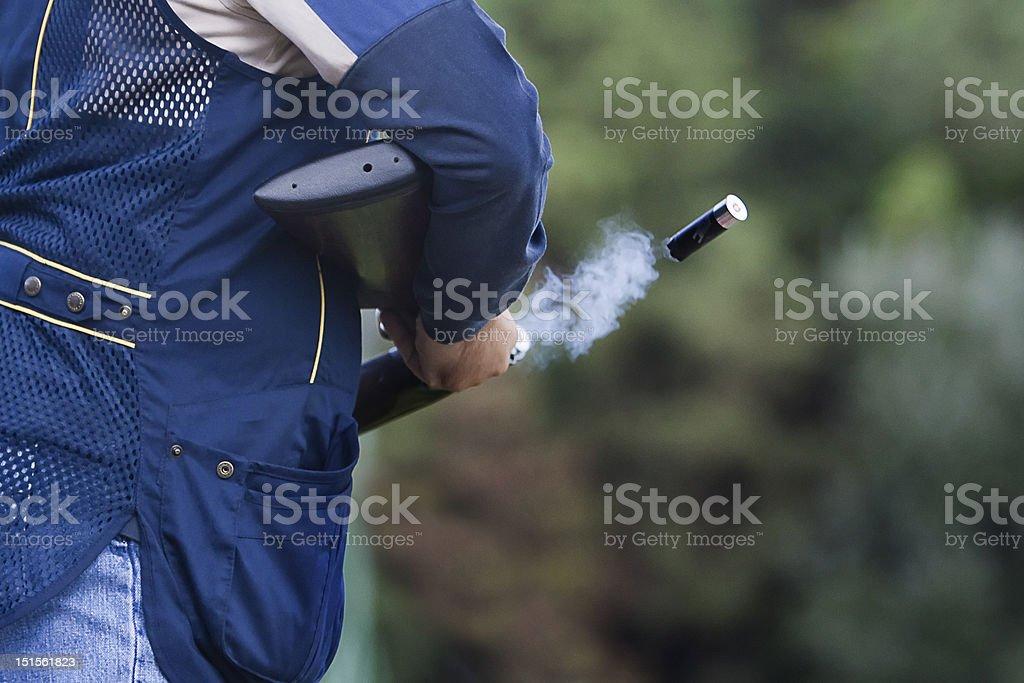 Shotgun throwing its shell stock photo