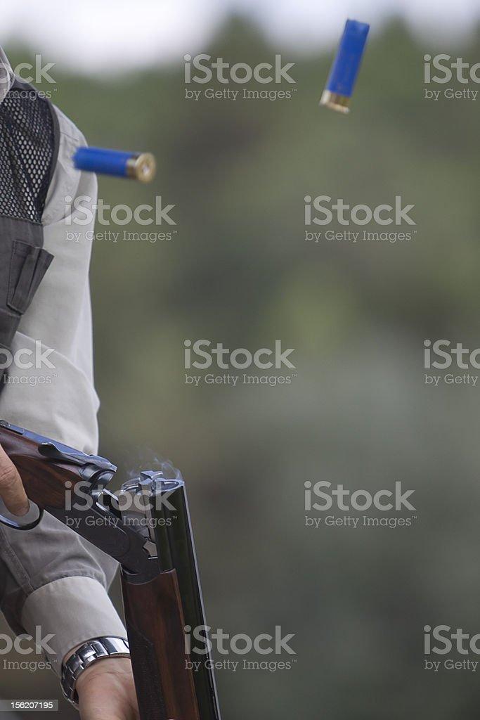 Shotgun throwing its shell royalty-free stock photo