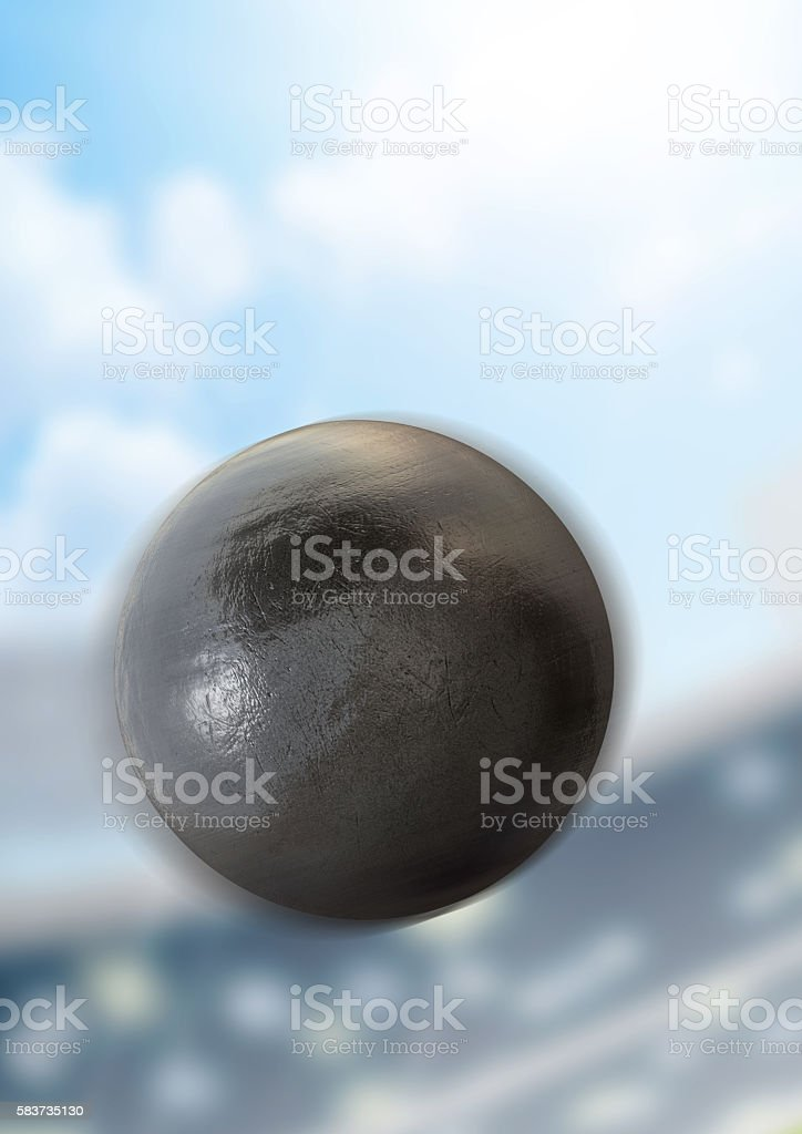 A shotput ball flying through the air in a generic sports stadium in...