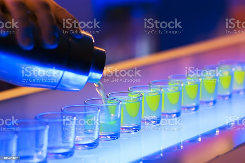 Shots on a bar with neon lights royalty-free stock photo