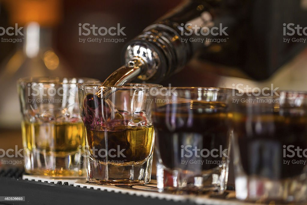 Shots with whisky and liqquor in cocktail bar stock photo