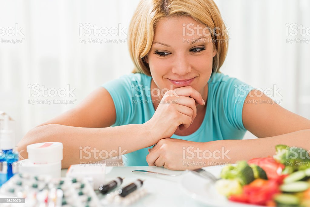 Should I use pills or eat salad? stock photo