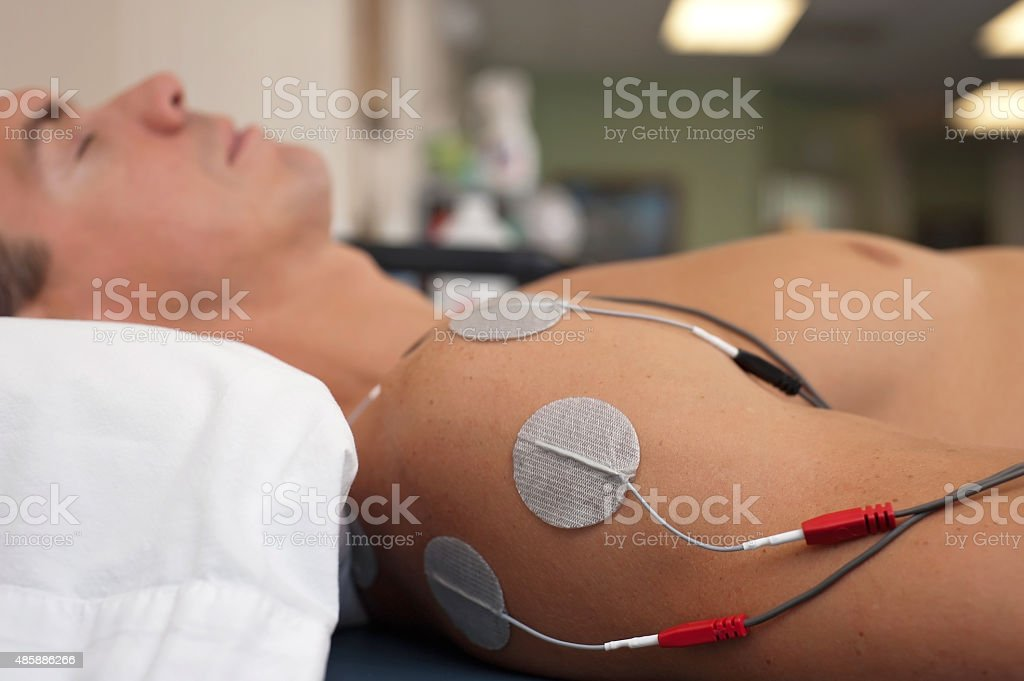 Shoulder Electrical Stimulation / TENS stock photo