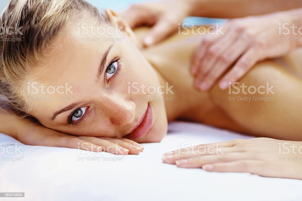 Shoulder massage - Young lady relaxing at a health spa royalty-free stock photo