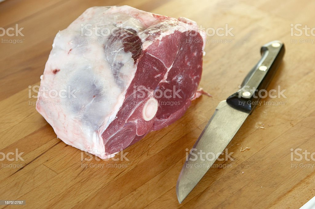 Shoulder of lamb with knife royalty-free stock photo