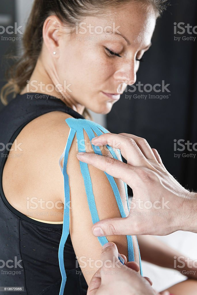 Shoulder treatment with kinesio tape stock photo