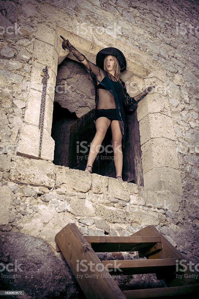 Shouting angry witch in an old castle stock photo