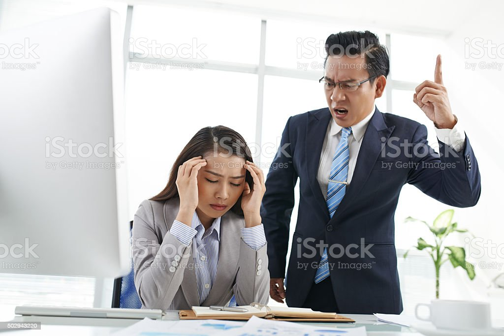 Shouting at assistant stock photo