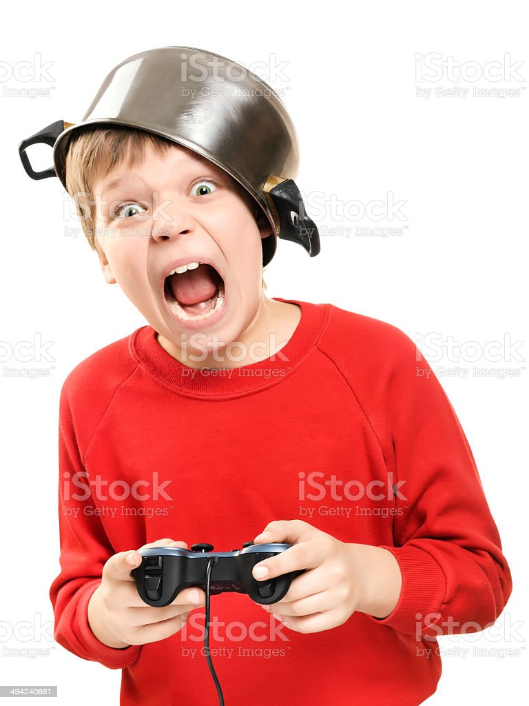 Shouting boy with gamepad in hands royalty-free stock photo