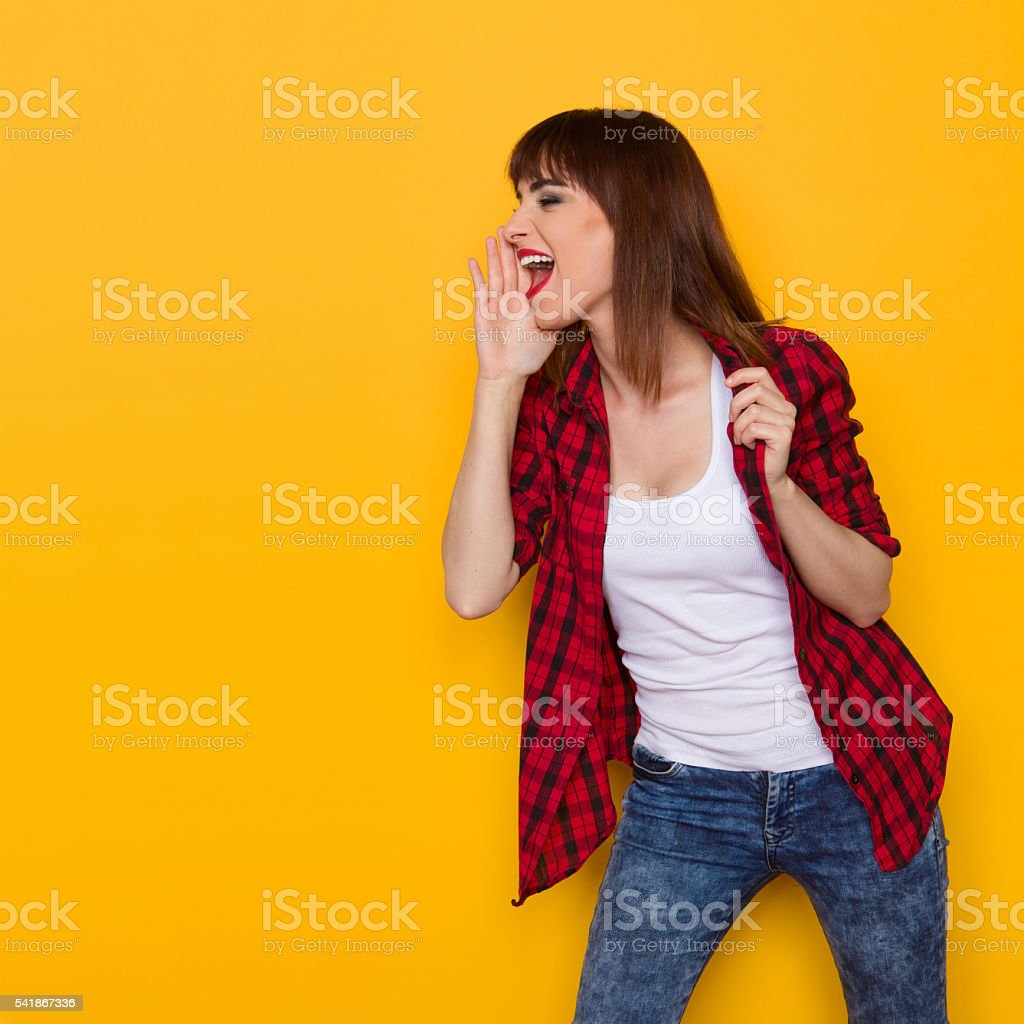 Shouting Casual Woman In Red Lumberjack Shirt stock photo