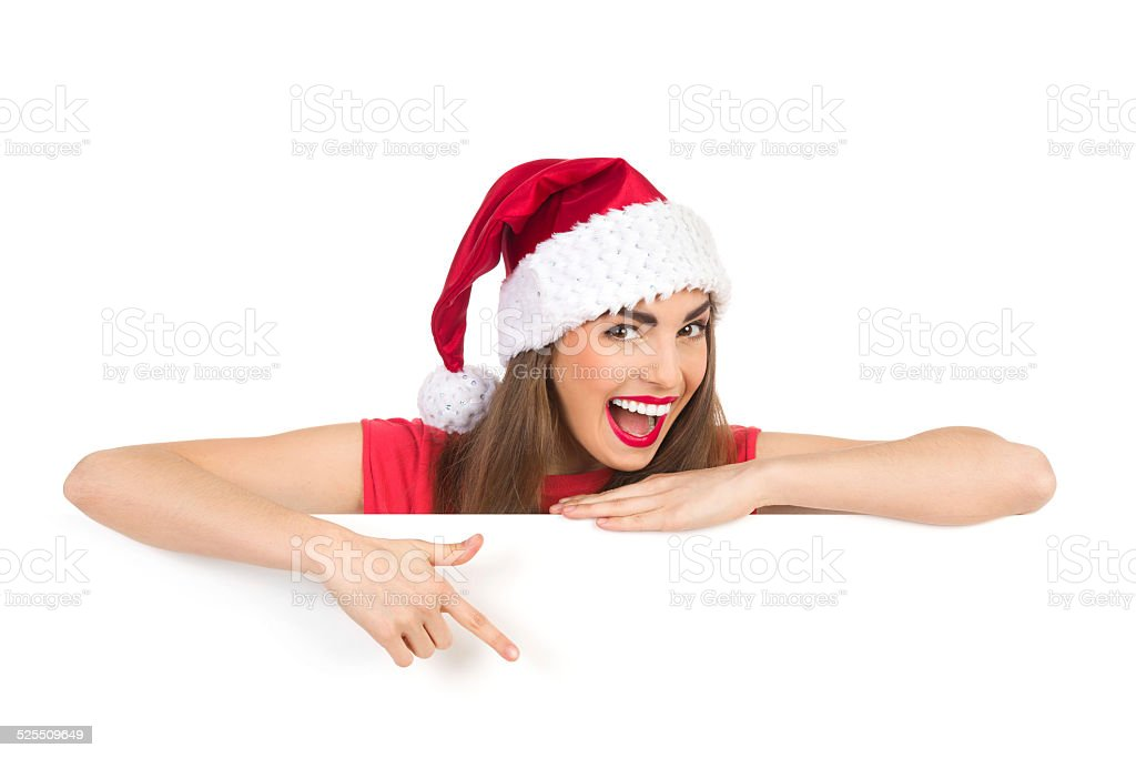 Shouting christmas girl pointing at the wishes stock photo