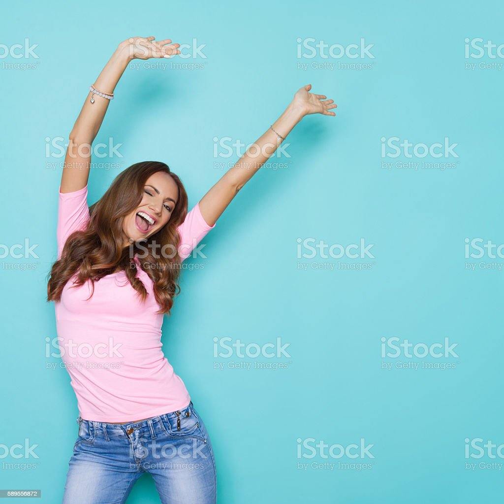 Shouting Girl With Arms Raised stock photo