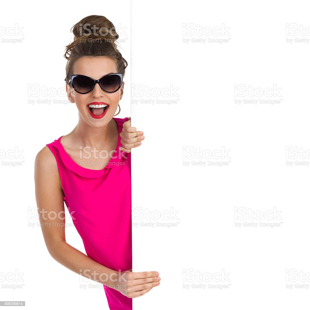 Shouting Girl With Topknot Peeking stock photo
