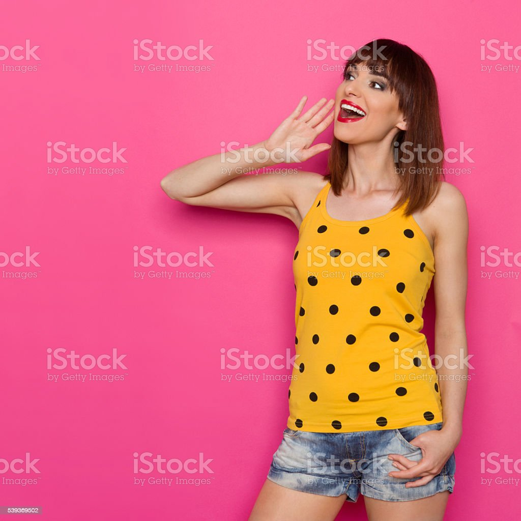 Shouting Happy Girl In Yellow Dotted Shirt stock photo