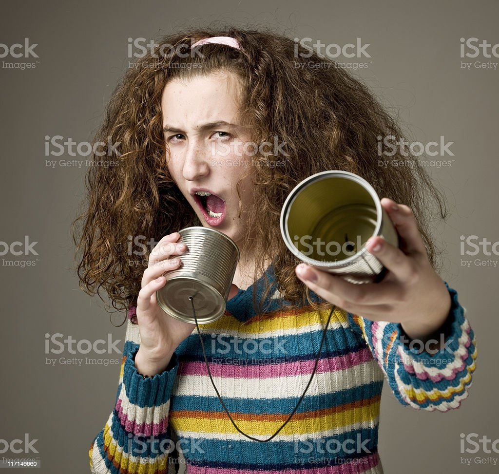 Shouting into a tin can phone stock photo