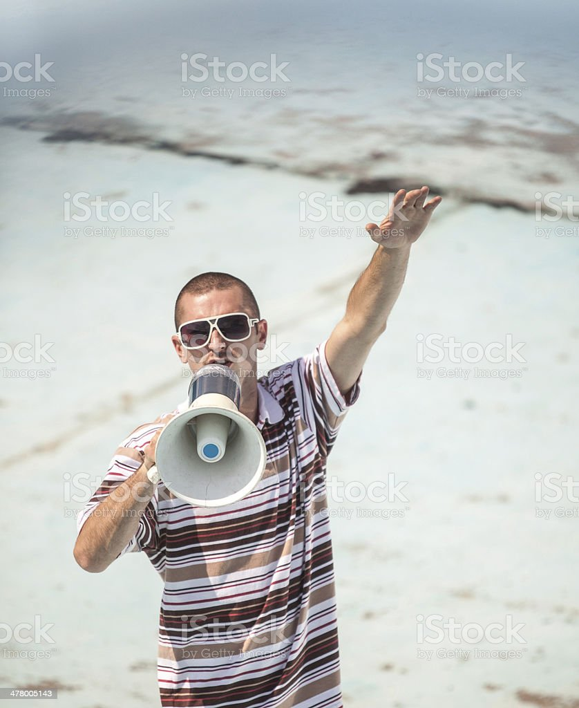 Shouting into megaphone royalty-free stock photo