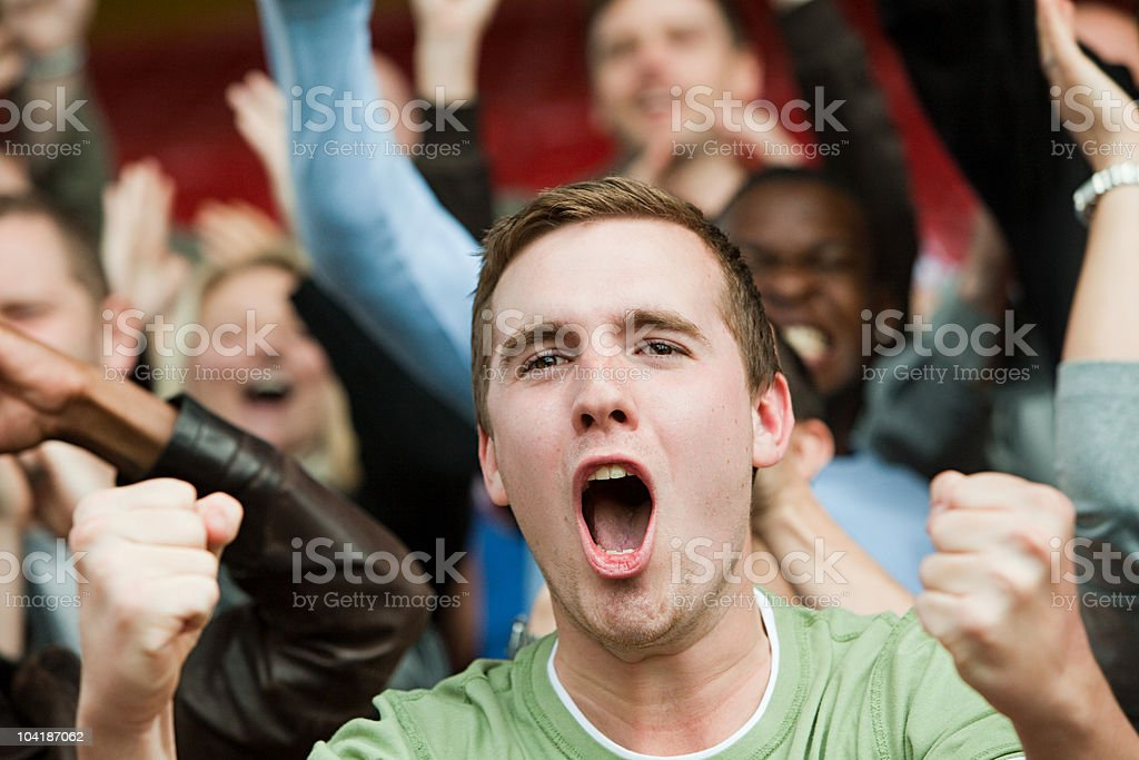 Shouting man at football match stock photo