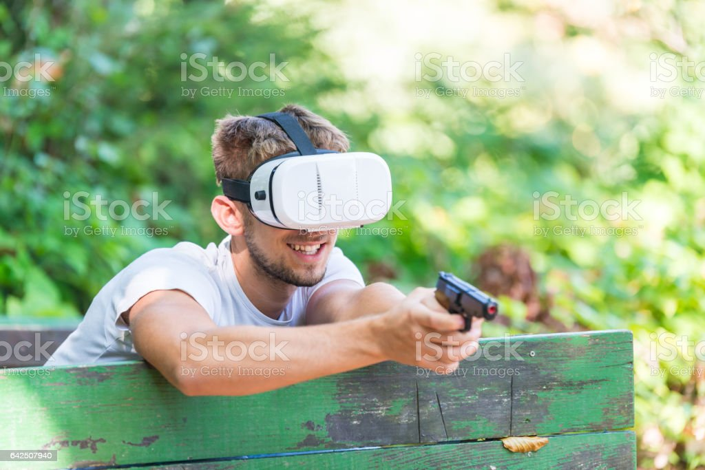 Shouting man in virtual reality headset playing video game stock photo