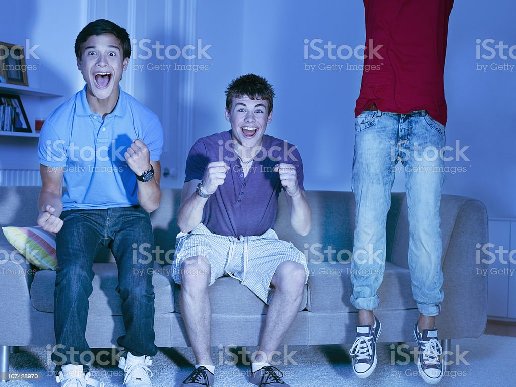 Shouting teenage boys watching television royalty-free stock photo