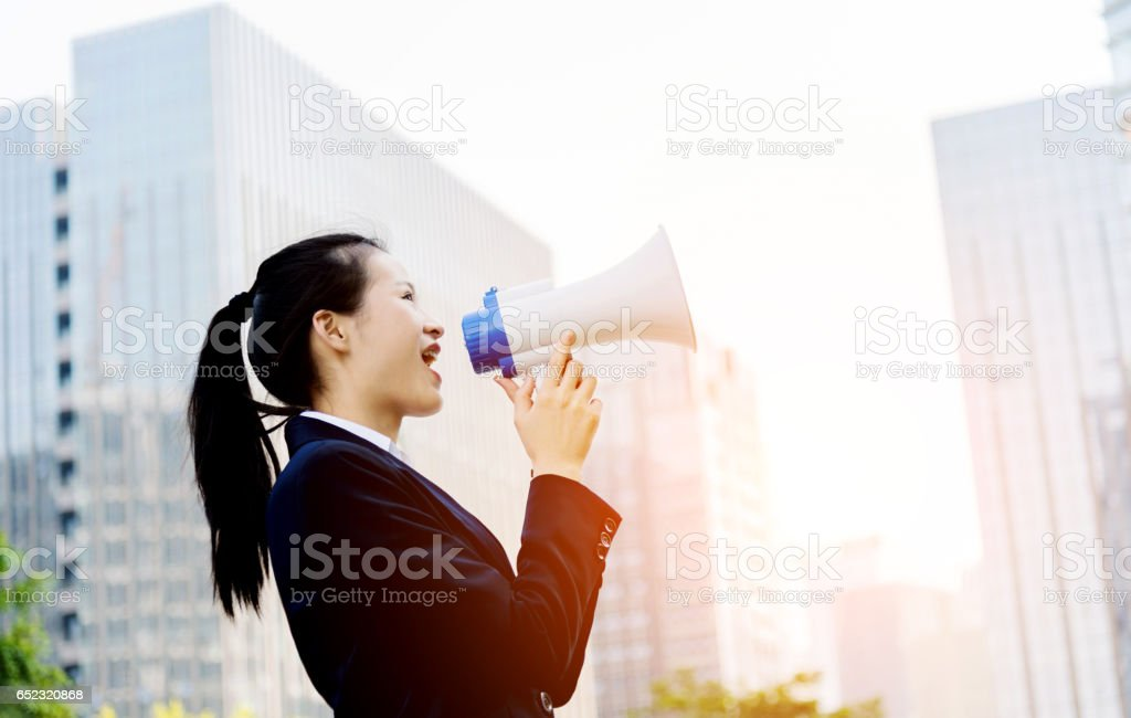 shouting through megaphone stock photo