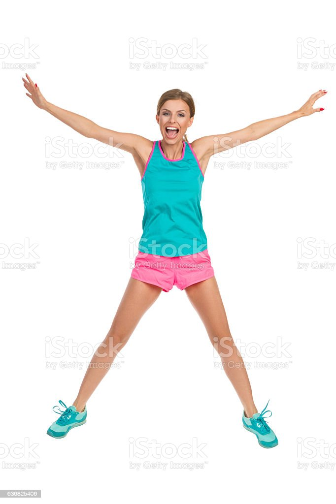 Shouting Woman Flying In Sports Clothes stock photo