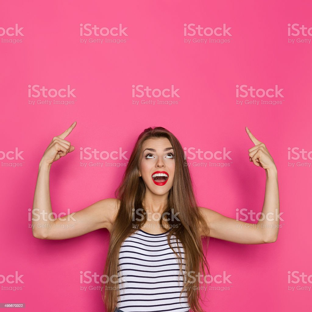 Shouting Woman Pointing Up stock photo
