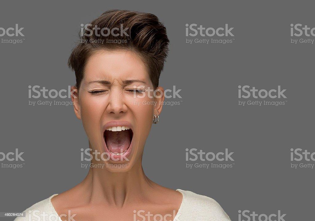 Shouting young woman stock photo