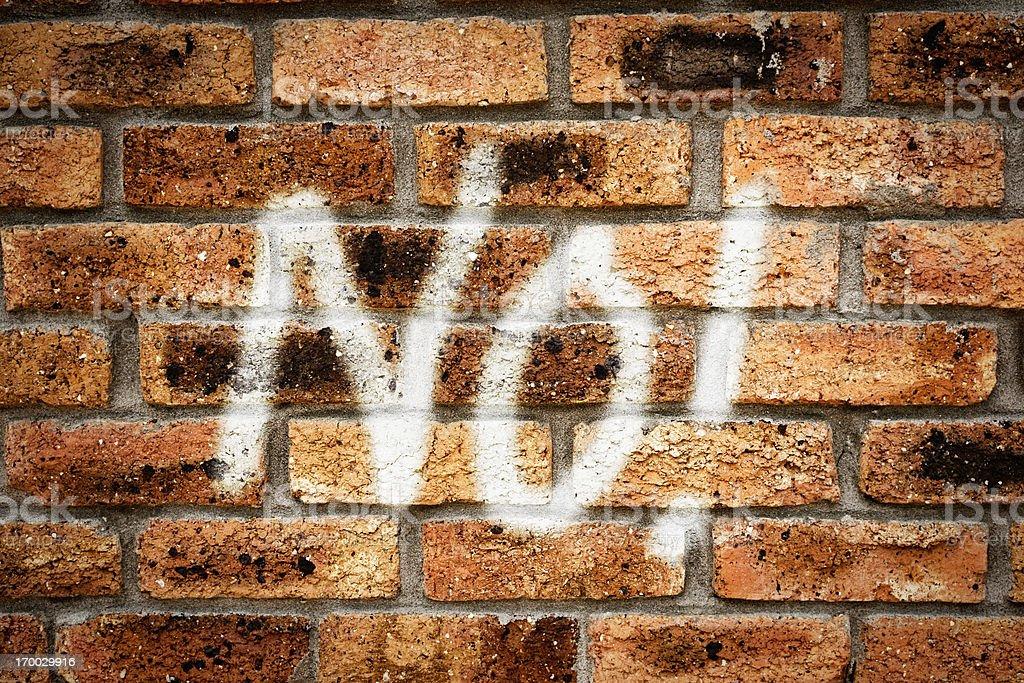 NO! shouts disapproving graffiti on grungy city wall royalty-free stock photo