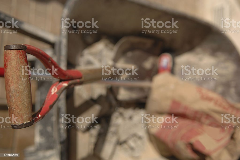 Shovel and bag of cement royalty-free stock photo