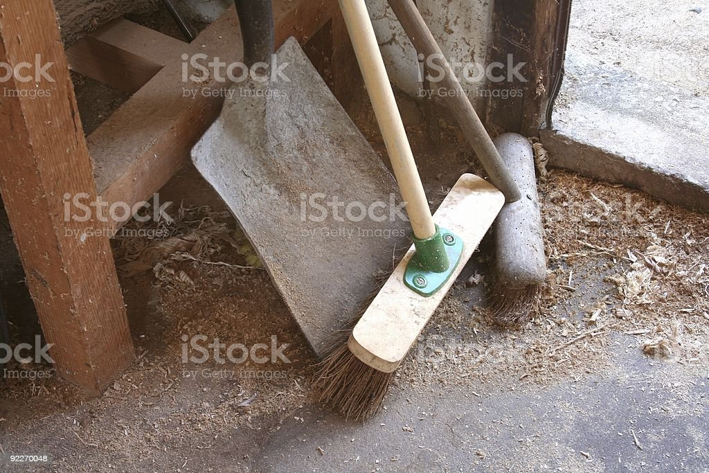 Shovel and Broom In Workshop royalty-free stock photo