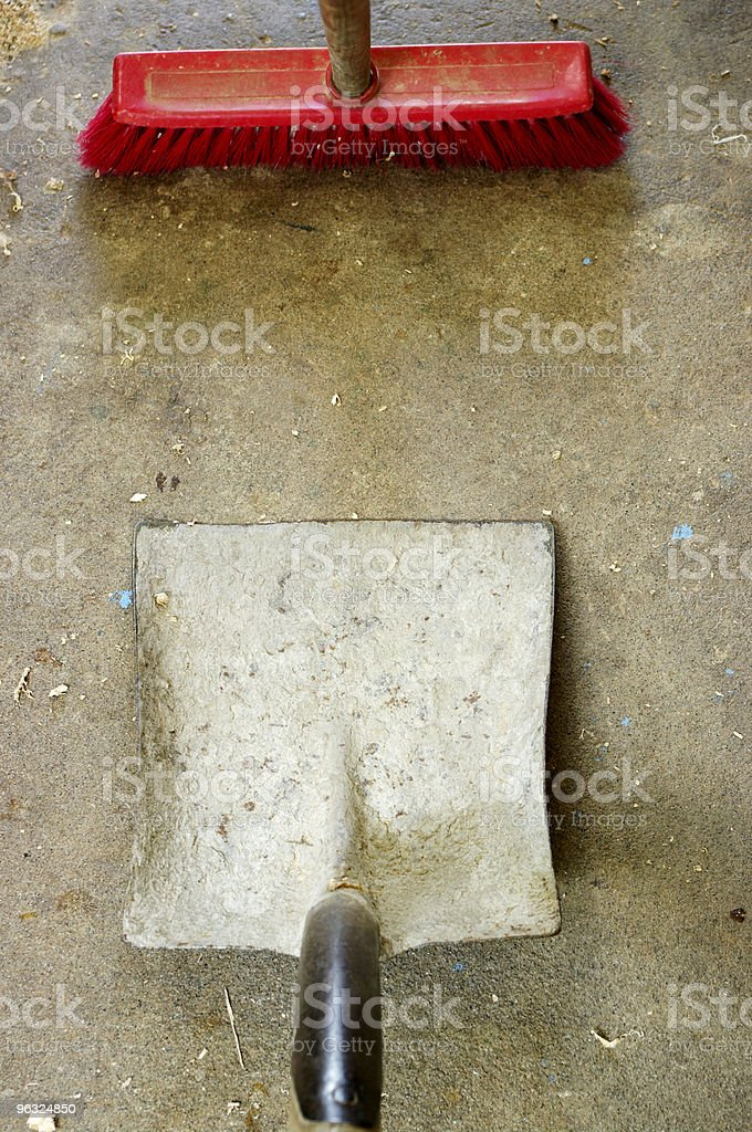 Shovel And Broom On Concrete stock photo