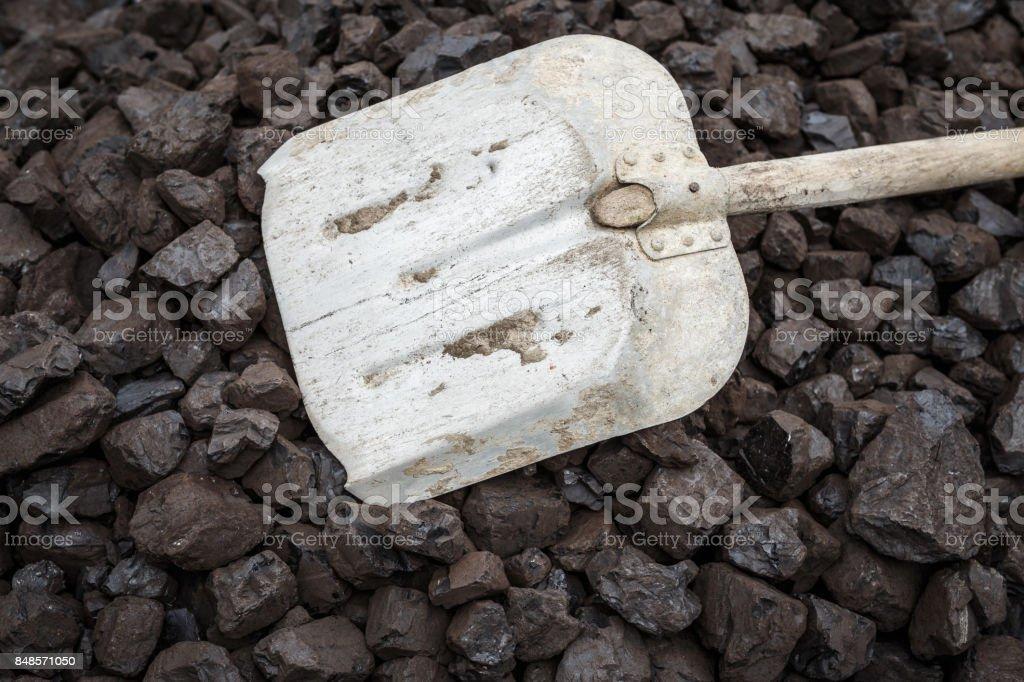 Shovel and coal, lignite storage stock photo
