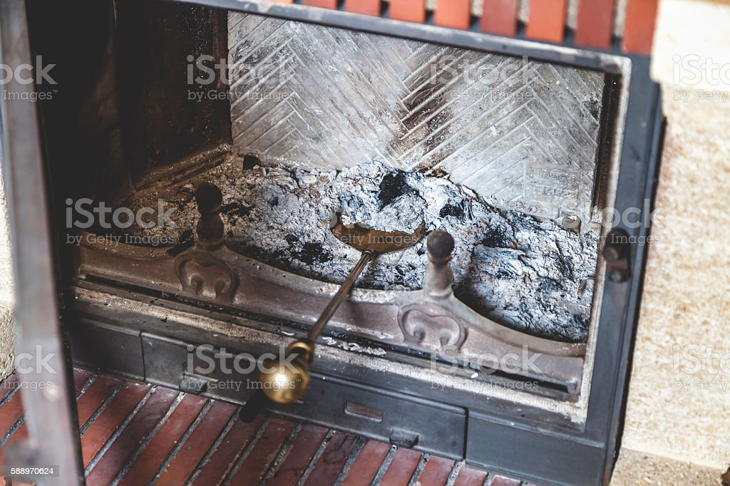 Shovel ash in furnace lay extinct fireplace stock photo