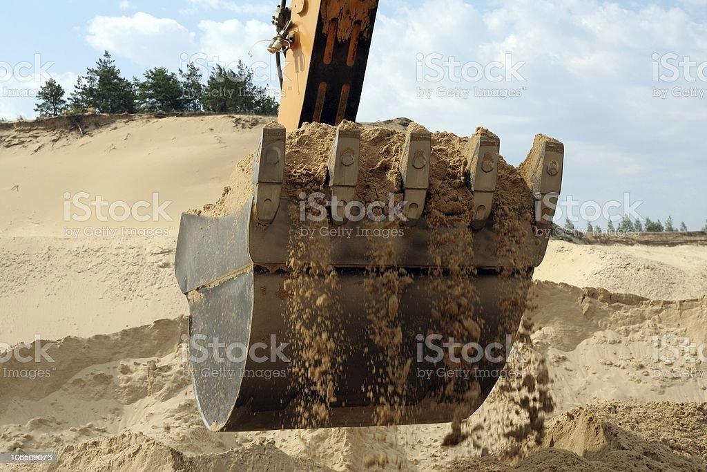 Shovel bucket full of sand stock photo