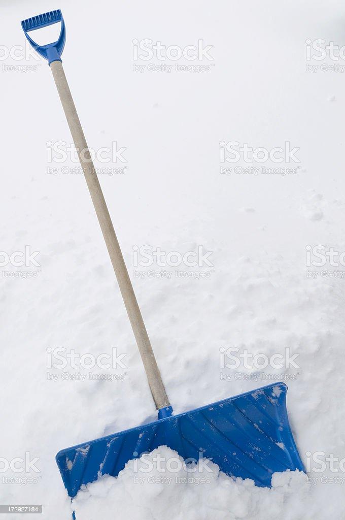 Shovel in snow stock photo