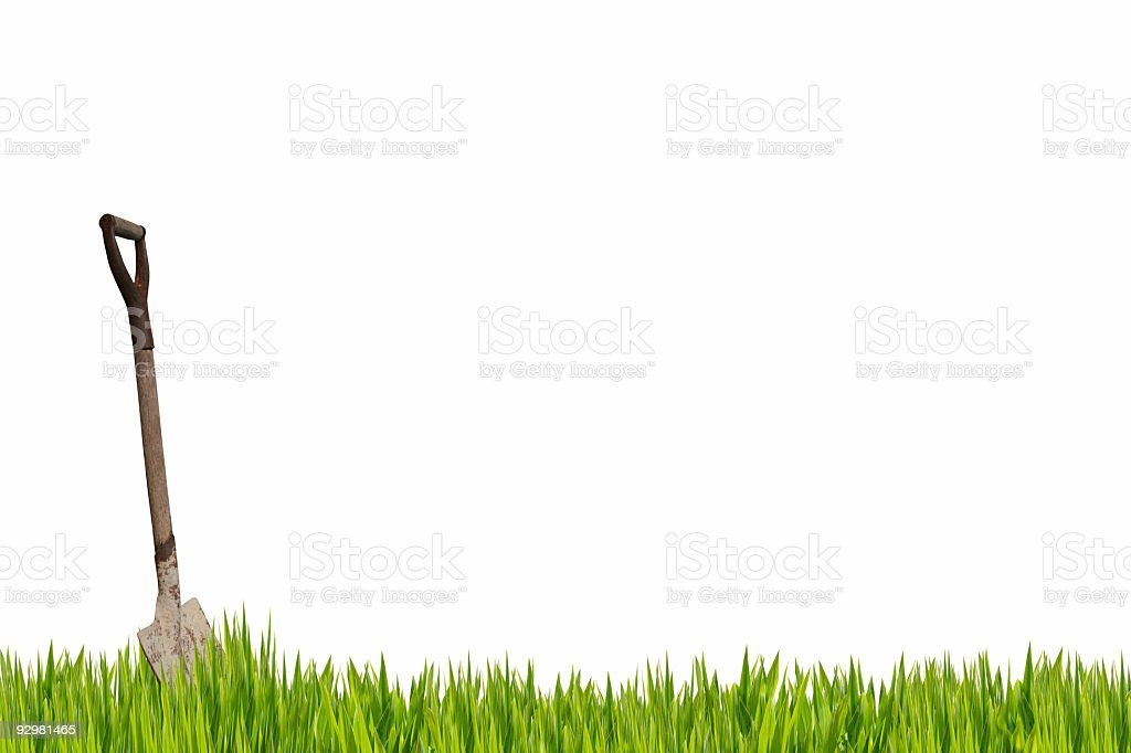Shovel in the grass royalty-free stock photo