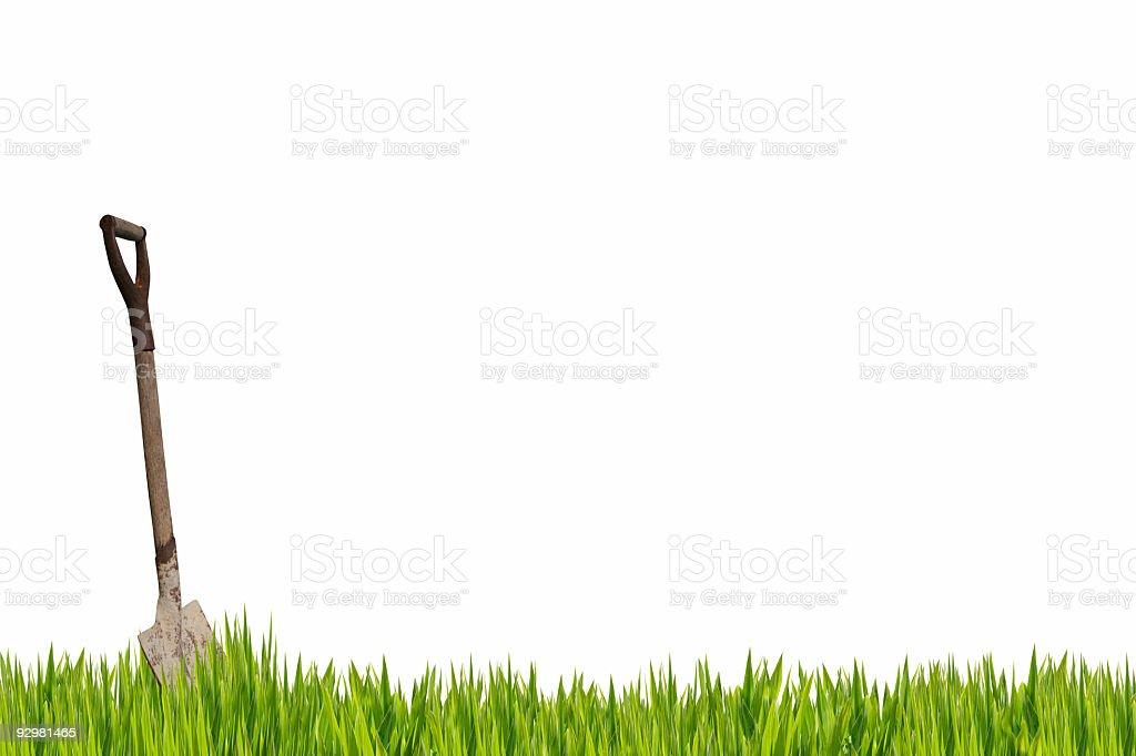 Shovel in the grass stock photo