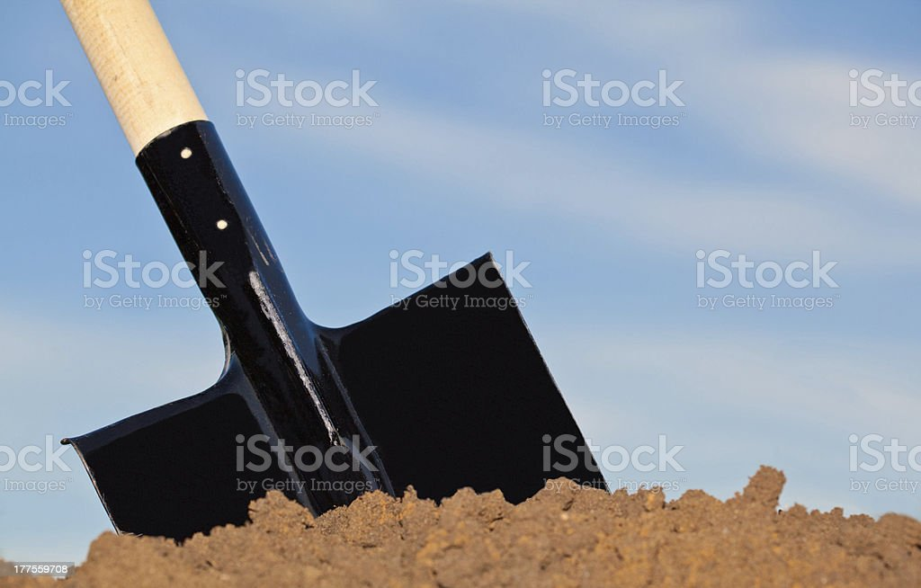 Shovel in the heap of ground stock photo