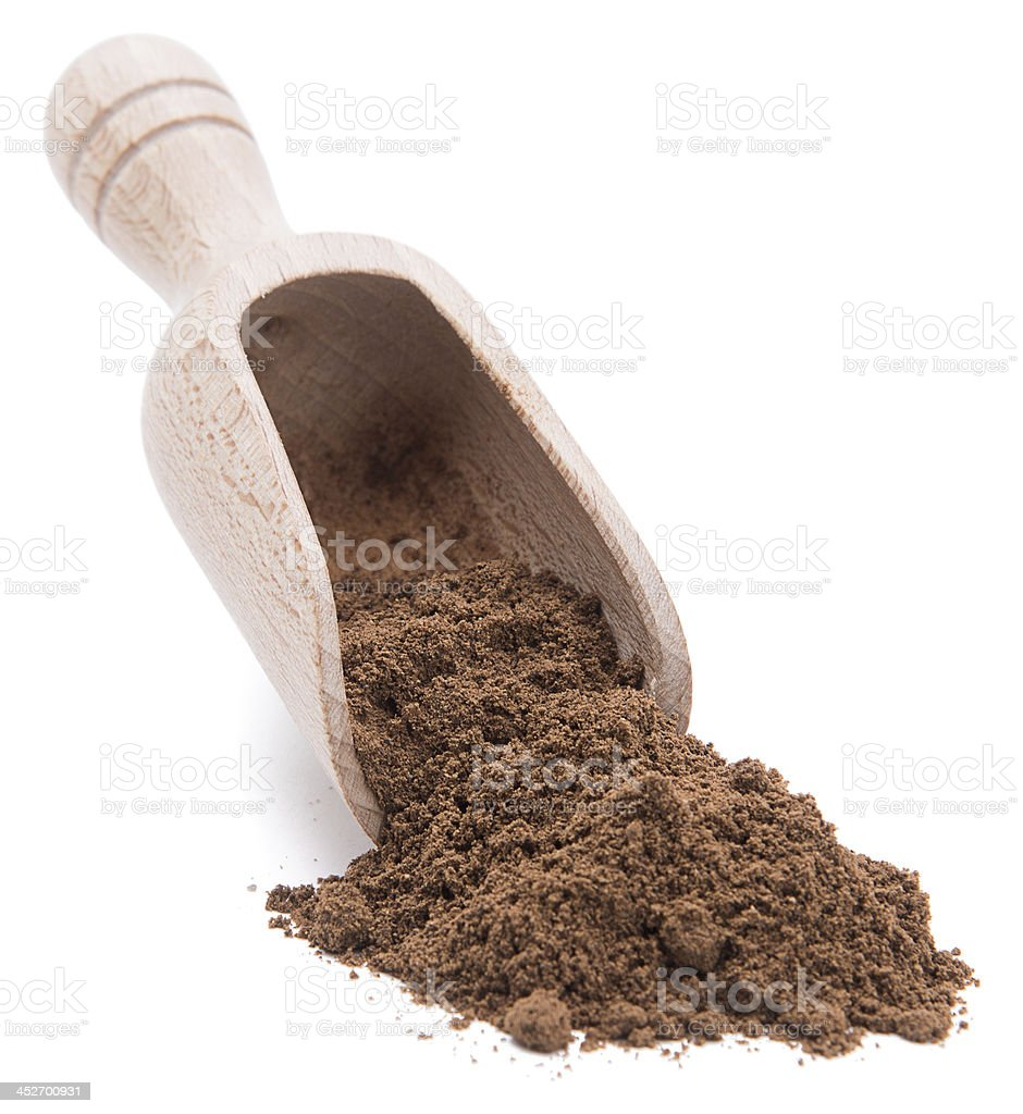 Shovel of Allspice stock photo