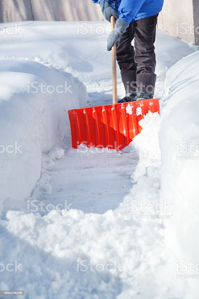 Shovel Snow on Sidewalk after Winter Blizzard Storm stock photo