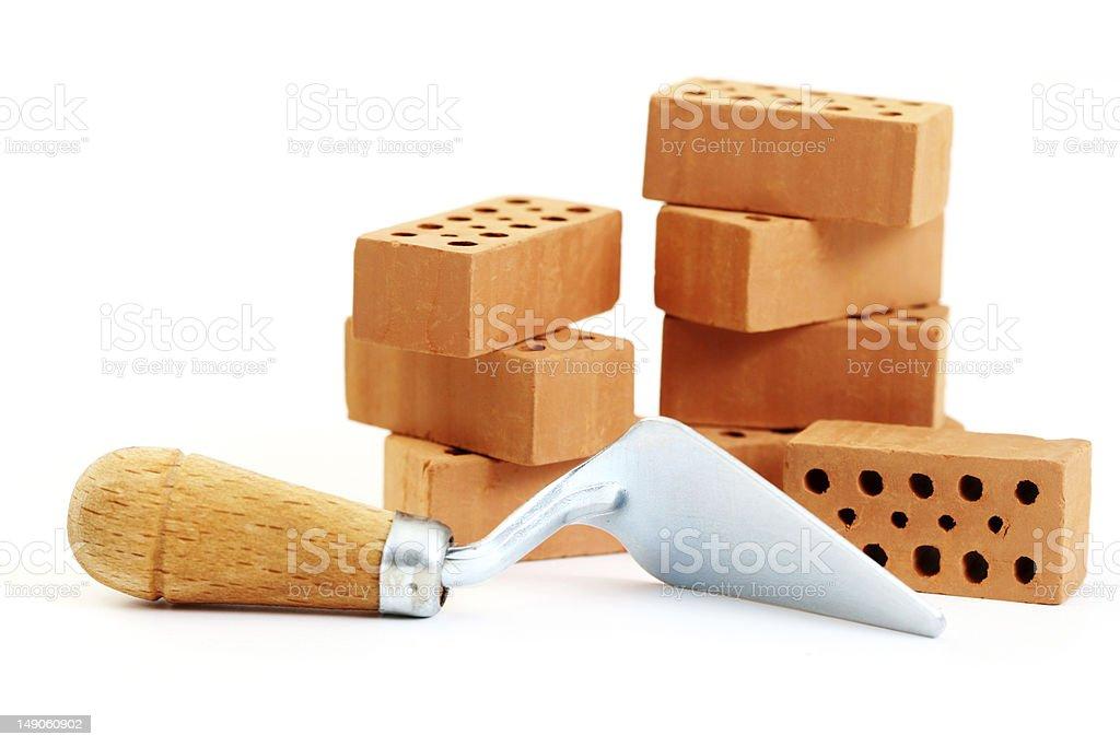 A shovel tool and several stacked bricks stock photo
