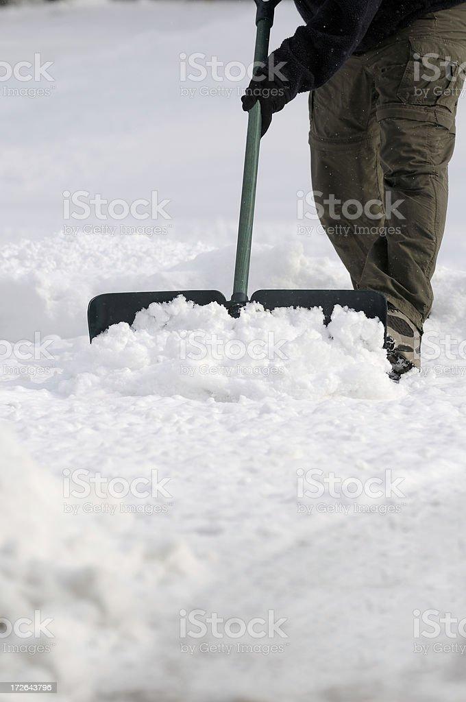 Shoveling the snow royalty-free stock photo