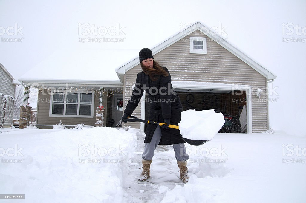 Shovelling driveway royalty-free stock photo