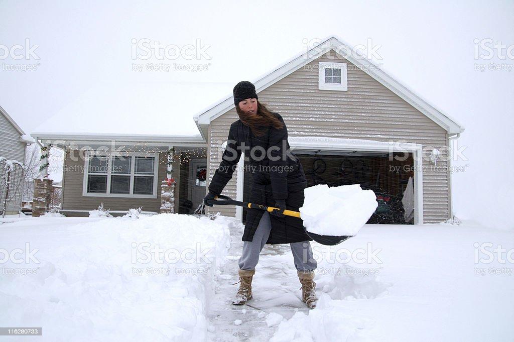Shovelling driveway stock photo