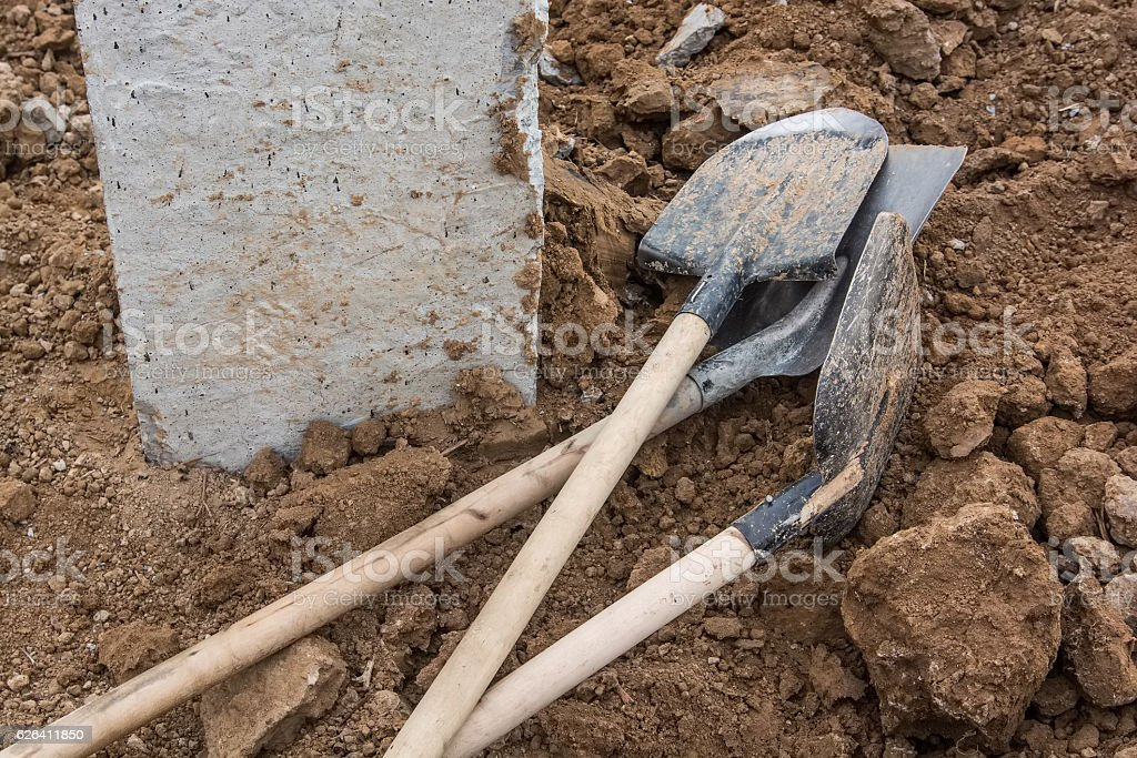 Shovels putted into heap of ground stock photo