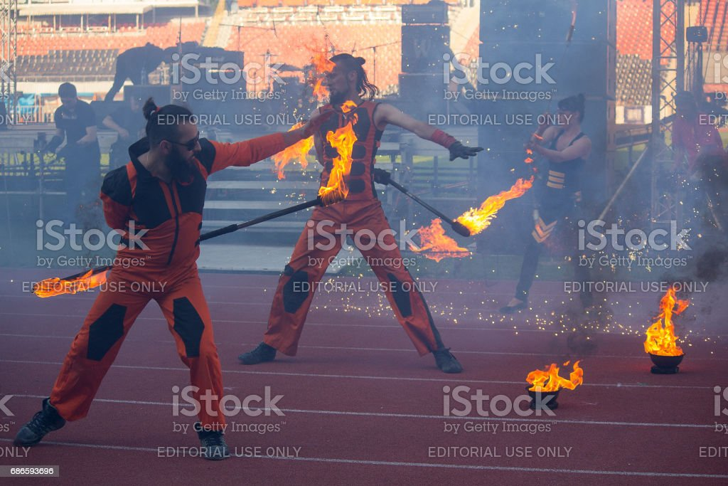 Show group performs with a torchlight procession stock photo