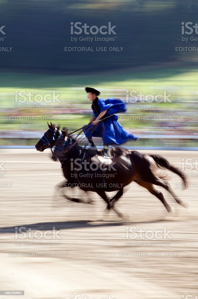 Show horse riding with movement blur stock photo